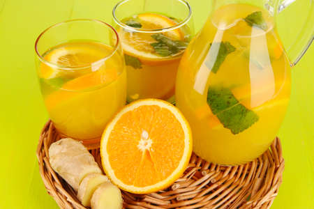 Orange lemonade in pitcher and glasses on wooden table close-up Stock Photo - 24629316