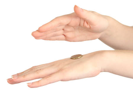 coin toss: Hands of woman flipping coin isolated on white