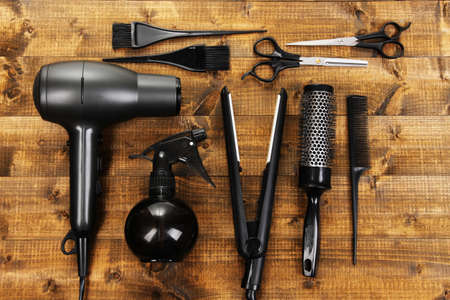 haircut: Hairdressing tools on wooden table close-up