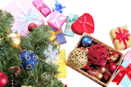 Decorated Christmas tree with gifts, close up,  isolated on white photo