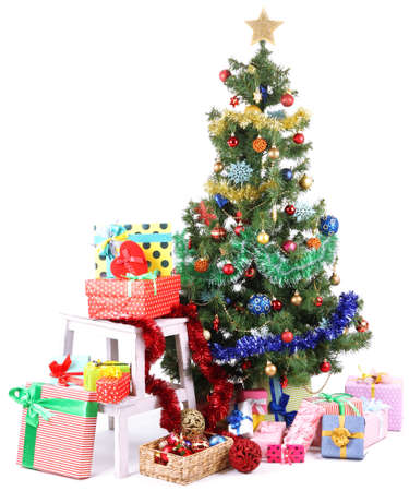 Decorated Christmas tree with gifts isolated on white photo