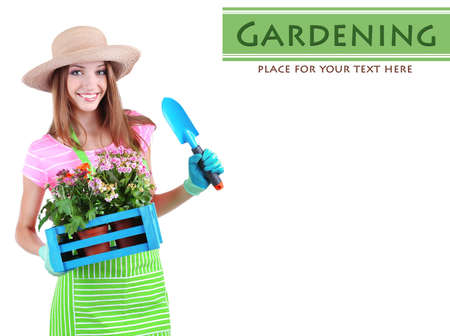 country girl: Beautiful girl gardener with flowers isolated on white