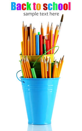 Colorful pencils and other art supplies in pails isolated on white photo