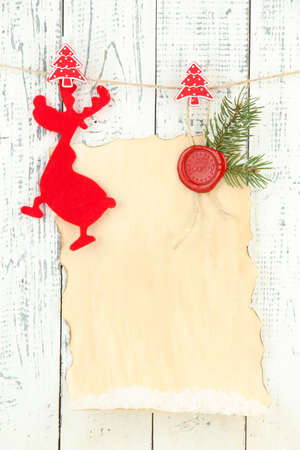 Blank Sheet With Christmas Decor Hanging On Grey Wooden Wall Stock ...