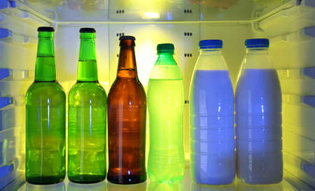 Refrigerator full of bottles photo
