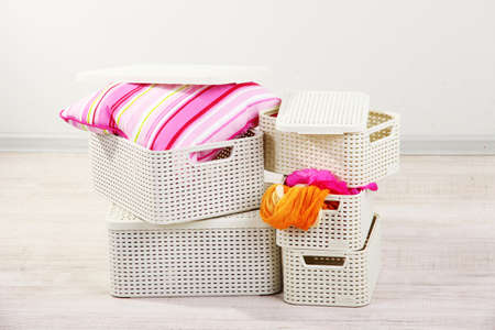roomy: Plastic baskets with things Stock Photo