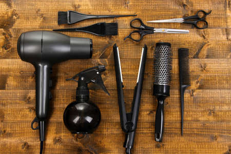 black barber: Hairdressing tools on wooden table close-up