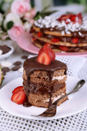 refine: Chocolate cake with strawberry on wooden table close-up Stock Photo