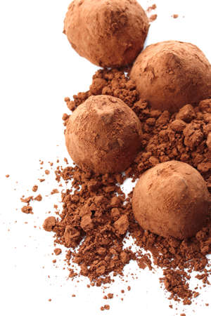 Chocolate truffles and cocoa, isolated on white photo