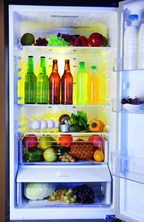Refrigerator full of food photo
