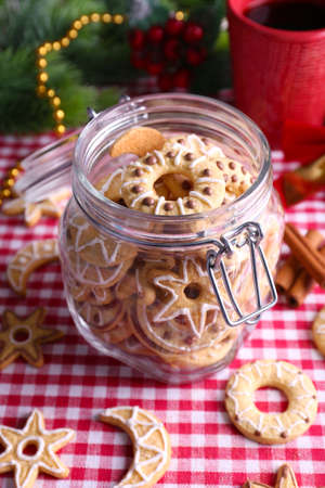 Delicious Christmas cookies in jar on table close-up photo