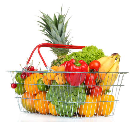 Assortment of fresh fruits and vegetables in metal basket, isolated on white photo