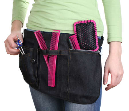 Woman hairdresser with tool belt isolated on white Stock Photo