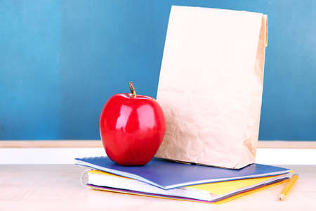 School breakfast on desk on  board background photo