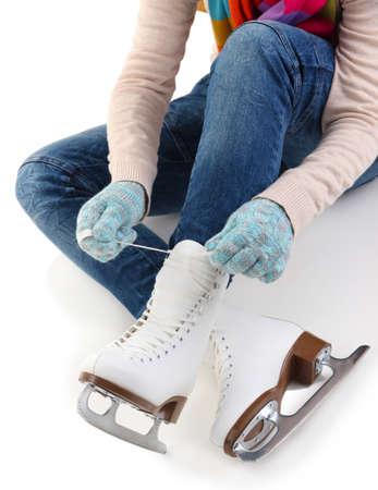 Skater wearing skates isolated on white photo