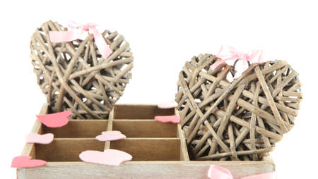 Hearts in wooden casket, isolated  on white background photo