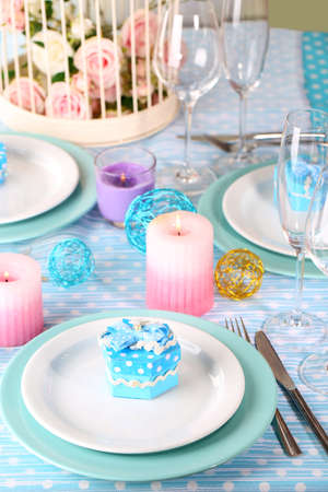 Table serving with colorful tableware close-up photo