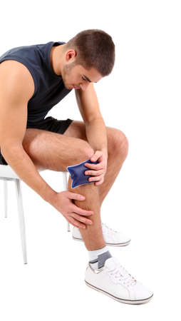 Young man with knee pain, isolated on white photo