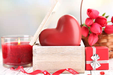 Romantic still life with heart in wooden casket photo