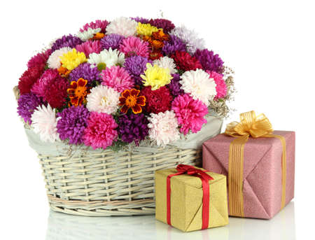 Beautiful bouquet of chrysanthemums in wicker basket isolated on white photo