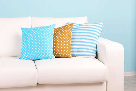 White sofa close-up in room on blue background Stock Photo - 24996184