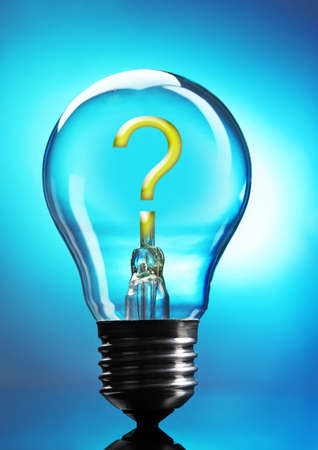 Question mark in lightbulb on blue background photo