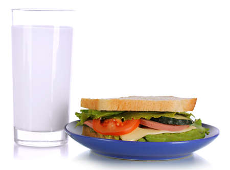 Sandwich on plate with milk isolated on white photo