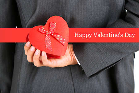 Young businessman holding present gift box, close up Stock Photo - 25011069