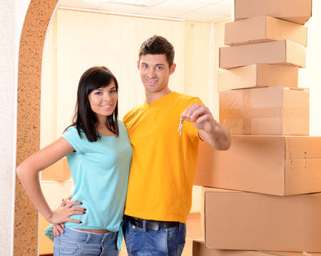 Young couple moves into new home photo
