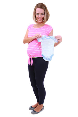 romper: Young pregnant woman holding blue romper isolated on white Stock Photo