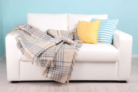 blue leather sofa: White sofa in room on blue background