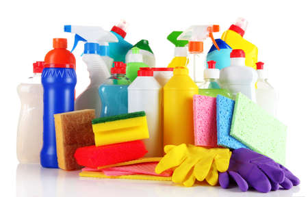 Different kinds of house cleaners and colorful sponges, gloves isolated on white photo