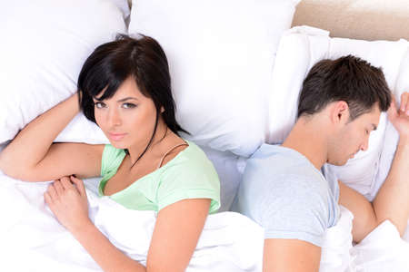 swear: Offended couple in bed