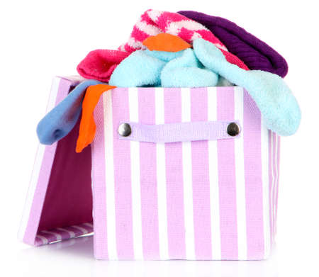 Textile box with different socks, isolated on white photo