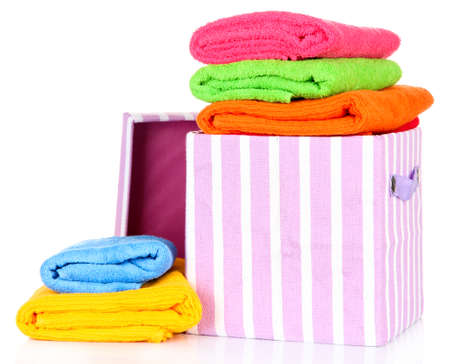 objec: Textile box with bright towels, isolated on white