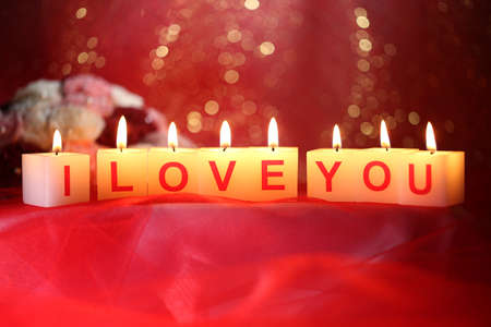Candles with printed sign I LOVE YOU,on  bright  photo