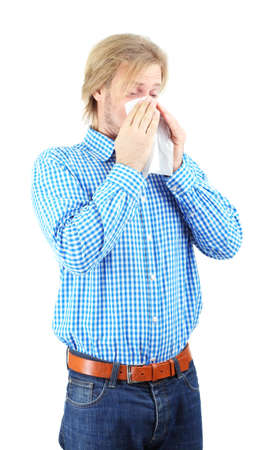 Sneezing young man isolated on white Stock Photo - 25428442