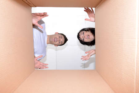 Young couple unpacking box photo