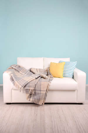 White sofa in room on blue  photo