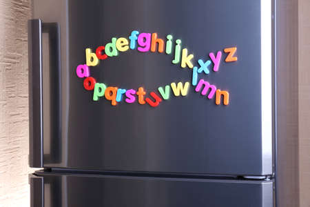 fish type: Colorful magnetic letters on  refrigerator