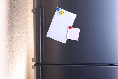 refrigerator kitchen: Empty paper sheets on fridge door Stock Photo