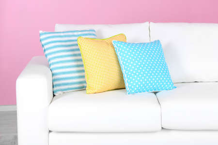 White sofa close-up in room on pink Stock Photo - 25145239
