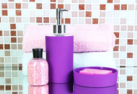 Cosmetics and bath accessories on mosaic tiles  photo