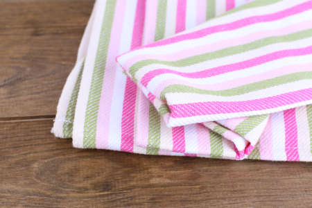 Kitchen towels on wooden  photo
