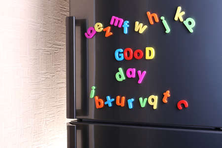 Colorful magnetic letters on  refrigerator photo