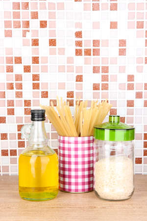 Products for cooking in kitchen on table on mosaic tiles background Stock Photo