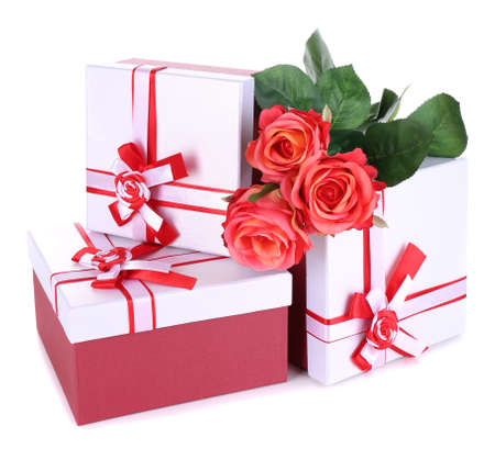 Beautiful gift boxes with flowers isolated on white photo