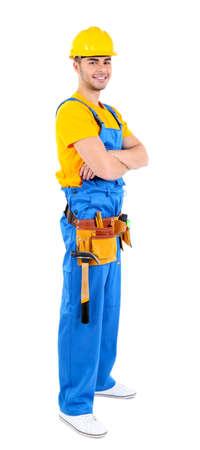 tool belt: Male builder in yellow helmet isolated on white