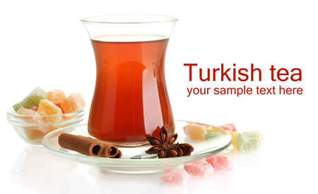Glass of Turkish tea and rahat delight, isolated on white photo
