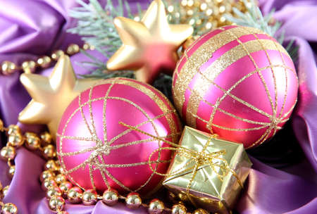 Beautiful Christmas decor on purple satin cloth photo